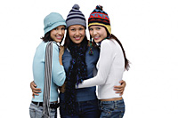 Three women wearing hats and scarves, smiling at camera - Asia Images Group