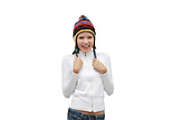 Young woman wearing winter hat, smiling at camera - Asia Images Group