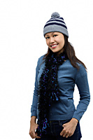 Young woman wearing winter hat and scarf, smiling at camera - Asia Images Group