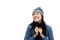 Young woman wearing winter hat and scarf, smiling - Asia Images Group