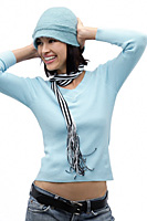 Young woman wearing hat and scarf, hands on head - Asia Images Group