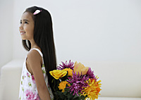 A young girl with a bunch of flowers - Asia Images Group
