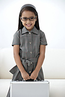 A young girl dressed in school uniform with glasses - Asia Images Group