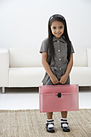 A young girl dressed in school uniform - Asia Images Group