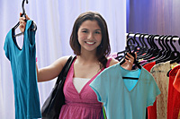 A teenage girl out shopping - Asia Images Group