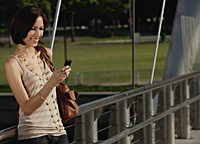 A woman uses her cellphone - Asia Images Group
