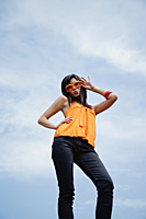 A woman with large sunglasses poses for the camera - Asia Images Group