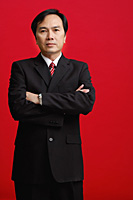 A businessman crosses his arms - Asia Images Group