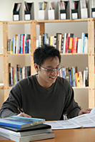 A young man studies in the library - Asia Images Group