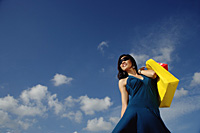 A young woman with shopping bags - Asia Images Group