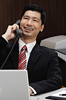 A businessman on the telephone - Asia Images Group