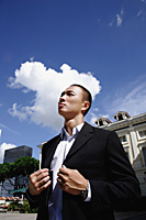 A man in a suit in the city - Asia Images Group