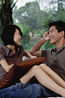 A young couple smile at each other - Asia Images Group