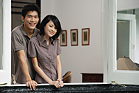 A young couple smile at the camera together - Asia Images Group