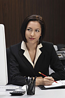 A woman working at her desk - Asia Images Group