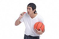 A man holds a basketball - Asia Images Group