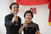 A couple raise their glasses for a toast - Asia Images Group
