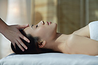 A woman has a relaxing massage - Asia Images Group