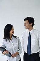 Two colleagues smile at each other - Asia Images Group