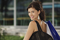 Woman with shoulder bag, looking at camera - Asia Images Group