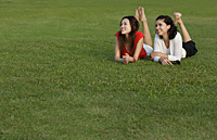 Women lying in park - Asia Images Group
