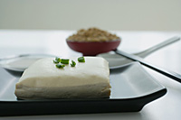 Still life of tofu with spring onions and soya beans - Asia Images Group
