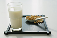 Still life of soya bean drink and soya beans - Asia Images Group