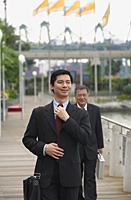 Businessmen walking on pier - Asia Images Group