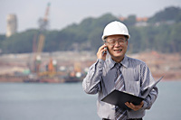Man with helmet, talking on the phone - Asia Images Group
