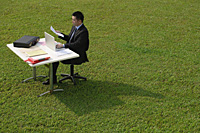 Businessman working at desk - Asia Images Group