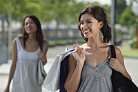 Young women shopping together - Asia Images Group