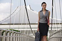 Businesswoman walking while looking into distance - Asia Images Group
