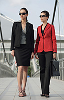 Two businesswomen looking into distance - Asia Images Group