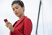 Businesswoman using mobile phone - Asia Images Group