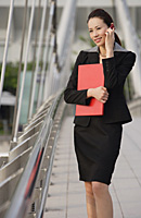 Businesswoman talking on the mobile phone - Asia Images Group