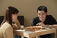 Couple playing board game - Asia Images Group