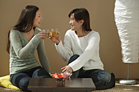 Friends toasting and looking at each other - Asia Images Group