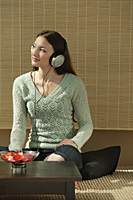 Young woman listening to music - Asia Images Group
