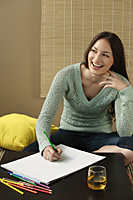 Young woman laughing and drawing - Asia Images Group