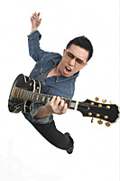 Man playing guitar enthusiastically - Asia Images Group
