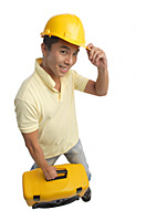 Builder with tool box smiling at camera - Asia Images Group