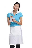 Waitress smiling at camera, taking order - Asia Images Group