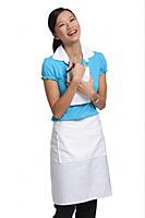 Waitress laughing at camera - Asia Images Group