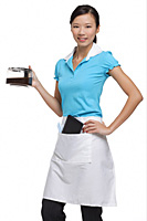 Waitress smiling at camera, holding coffee - Asia Images Group