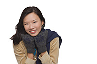 Woman freezing and smiling at camera - Asia Images Group