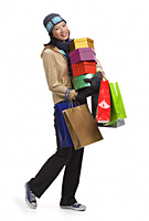 Young woman with gift boxes and shopping bags, smiling at camera - Asia Images Group