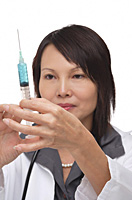 Doctor with syringe - Asia Images Group