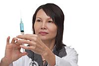 Doctor holding syringe - Asia Images Group