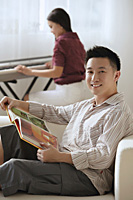 Couple relaxing at home - Asia Images Group