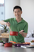Man cooking in the kitchen - Asia Images Group